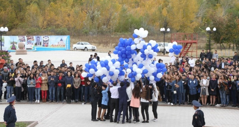 Students of Shakarim University releasing balloons and origami cranes as their message of peace